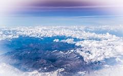 In Heaven (marionrosengarten) Tags: heaven sky clouds mountains alps flight high aircraft blue nikon wolken himmel flug flugzeug vignette