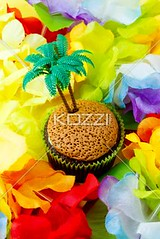 close-up image of cupcake with plastic coconut tree miniature surrounded by colorful flowers (dreyfood8877) Tags: birthday flowers party food flower cake closeup dessert toy creativity photography miniature yummy colorful display anniversary small decoration tasty nobody nopeople sugar lei petal gourmet plastic indoors celebrations cupcake snack junkfood coconuttree muffin multicolored tiki abundance surrounded foodanddrink displayed confectionery baked tempting toppings prepared colorimage readytoeat sweetfood unhealthyeating desserttopping
