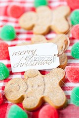 image of a merry christmas tag with gingerbread candies (bacafood8877) Tags: christmas xmas closeup photography order candy napkin tag gingerbread nobody nopeople indoors event homemade repetition icing studioshot shape merrychristmas sidebyside information occasion making arrangement foodanddrink topview preparation confectionery gingerbreadman conformity identical arranged anthropomorphic selectivefocus inarow checked preparingfood colorimage christmaspreparation differentialfocus sweetfood unhealthyeating malelikeness humanrepresentation westernscript gingerbreadcandy xmaspreparation anthropomorphicface publiccelebratoryevent