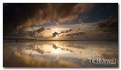 Between the clouds (Simon Bone Photography) Tags: sea sky cloud sun reflection beach silhouette sand cornwall wideangle gwithian sigma1020mm cornishcoast cornishsunsets wwwthehidawaycouk canoneos7d hitechnd09reversegrad