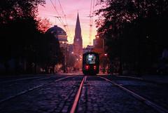 enamored (ewitsoe) Tags: street city morning autumn trees sun fall church beautiful train sunrise europe traffic tracks tram poland streetcar poznan fredry