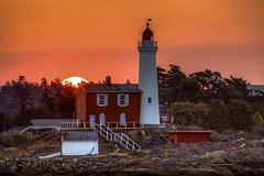 7523 (Paul Rioux) Tags: ocean morning sea lighthouse silhouette sunrise bc harbour britishcolumbia victoria calm vancouverisland fisgard esquimalt calmwater colwood westshore fisgardlighthouse fordroddhill prioux