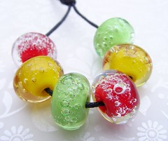 Christmas Bubbles (Glittering Prize - Trudi) Tags: christmas red holiday green glass lights golden amber beads traffic bubble reggae lampwork artisan