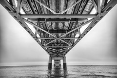 A Trolls Home (Rudy Malmquist) Tags: city bridge bw white lake black water mi wonder concrete crossing angle suspension michigan great wide lakes engineering marvel huron girders mackinac supports mackinaw