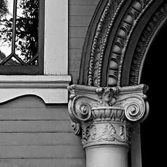 a pillar of the community (msdonnalee) Tags: shadow reflection window facade ventana arch pillar entrance reflejo architektur janela curve fachada refleccion entry faade facciate arqitetura   reflisse larqitecture