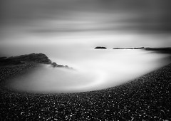 Circular Bay (annemcgr) Tags: longexposure sea dublin seascape beach water monochrome clouds rocks stones minimal le malahide