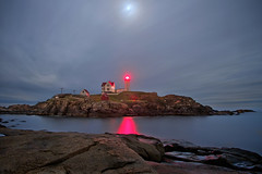 Outshine the Moon - in explore (SunnyDazzled) Tags: ocean longexposure light red sea moon lighthouse seascape reflection tower beach station night island coast colorful maine moonlight nightsky couds nubble capeneddick lightkeepershouse takenin3layers