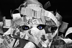 Buried under the news - Burqa (Laurent photography) Tags: wallpaper blackandwhite bw stilllife paris france color art colors french geotagged photography nikon europe flickr nb hd nikkor fx anawesomeshot d700 facesofportraits paris1er laurentphotography