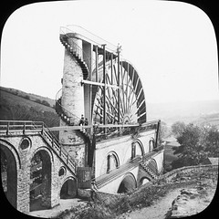 """Elaborate technical wheel"" is of course the Laxey Wheel, Isle of Man (National Library of Ireland on The Commons) Tags: thomasholmesmason thomasmayne thomashmasonsonslimited lanternslides nationallibraryofireland elaboratetechnicalwheel tower spiralstaircase hydroelectric ladyisabella wheel pump isleofman laxeywheel greatlaxeywheel"