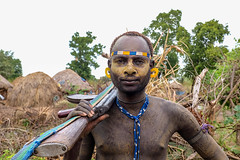 Mursi Warrior, Ethiopia (Rod Waddington) Tags: africa african afrika afrique ethiopia ethiopian ethnic etiopia ethnicity ethiopie etiopian omovalley omo outdoor thiopien mursi tribe traditional tribal mago male warrior portrait painted face scarification ak47 gun weapon huts village