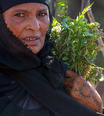 Sharp eyes, Golden Teeth, Palm Tattoo and Basil Leaves (ybiberman) Tags: tattoo israel jerusalem nun basil oldcity alquds ethiopian mountofolives goldenteeth thereturnofthemothermaryiconprocession tombofthevirginmarychurch