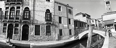 sketching by the canal (pho-Tony) Tags: venice bw italy white 3 black film 35mm lens lomo lomography horizon 28mm it panoramic ishootfilm swing ilfordhp5 plus hp5 swinglens analogue 135 russian venezia perfekt ilford horizon202 202 industar veneto hp5plus russiancameras kompakt ilfosol filmisnotdead  horizon perfeckt ilfosol3 laserenessima  202 multicamsource