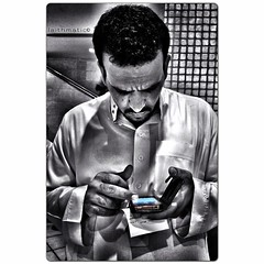 A Man and his phone (Laithmatic) Tags: blackandwhite man candid bandw colorsplash bnw bwbeauty bwlover iphone4s