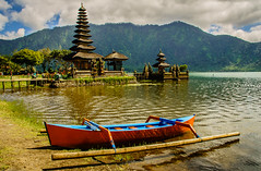Skiff by temple (Fredde Nilsson) Tags: bali mountain lake indonesia temple boat sony jungle nex munduk