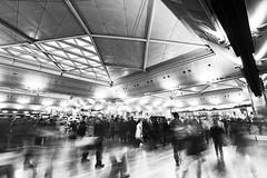 ... (Wael Massalkhi) Tags: longexposure travel people bw motion blur speed turkey moving airport chaos airplanes istanbul handheld passenger flights schedule istanbulairport