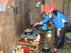 Our Giay hostess and our guide cooking (Linda DV (away)) Tags: travel canon geotagged asia southeastasia vietnam zai sapa 2012 zay giay lindadevolder powershotsx40