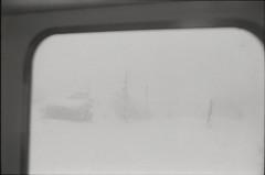 0968 (nori 4_4) Tags: snow japan 11 d76 m42 niigata  trainwindow  selfdeveloped ilfordfp4 czj bessaflextm pancolar5018