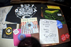 Obits Loot N' Swag (Wires In The Walls) Tags: nyc newyork records shirt table funny manhattan stickers vinyl 45 single subpop merch cakeshop pricing 7inch rickfroberg 2013 obits metodayyoutomorrow