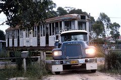 Albie Richardson's Mack B61 Prime Mover and semi trailer FSS-343 with the Sydney Tramway Museum (STMs) newly purchased OP class tram 1089 turning from Gordon Avenue into a property at Macquarie Fields, N.S.W, Australia.