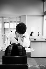 with his chin resting on his hand (Masaaki Kasamatsu) Tags: city bw japan tokyo town cafe note lookdown fujifilm tokyodays xpro1 xf35mmf14r