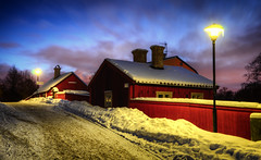 House of Master Per (Henrik Sundholm.) Tags: road trees houses windows winter light red snow signs lamp clouds landscape evening alley sweden stockholm sdermalm dusk hill tracks dramatic dirt sverige pastoral vignette hdr antenna chimneys vitabergen msterpersgrnd bergsprngargrnd
