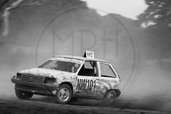 North Wales Autograss (MPH94) Tags: north wales autograss nw car cars auto motor sport motorsport race racing motorracing dirt dirty dust dusty canon 500d 70300 offroad off road black white monochrome vauxhall nova