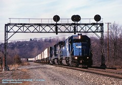 CR 6760 e, Manor, PA. 11-15-1994 (jackdk) Tags: train railroad railway locomotive emd emdsd60 sd60 emdsd60m sd50 emdsd50 cr conrail signal signalbridge signals railroadsignal positionlight possitionlights prr pennsy manor manorpa tractortrailer tofc