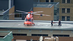 Rescue Helicopter (soniaadammurray - OFF) Tags: digitalphotography happymacromonday helicopter heliport rescuers stretcher toronto ontario canada crisis macro people help men disaster humanity teamwork life working