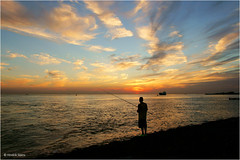 Fisherman (Hindrik S) Tags: fisherman visser fisker fischer sea zee see meer vlissingen westerschelde schelde sun sunset sinne sinnendergong zon zonsondergang evening avond jn dike shore wl kust coast sky skytheme bluesky blue red yellow sonyphotographing sony sonyalpha a57 57 slta57 tamron tamronaf16300mmf3563dillvcpzdmacrob016 16300 tamron16300 2016 noordzee zeeland northsea nordsee noardsee