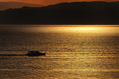 Sailing In Silhouet (Alfred Grupstra Photography (bussy until 30 octobe) Tags: boat lakeohrid lake mountains silhouet water