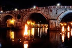 Fires ablaze under the Ponte Sisto.