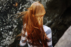 (Mary Jo.) Tags: girl rock canon hair 50mm ginger movement wind mj tunnel redhead manual xs f18 swoosh rebe mossrock