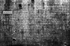 Reserved (Daniel_Lamb) Tags: white black brick wall minolta grain leeds reserved