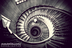 Helix of Beauty - Revisited (Aaron Yeoman) Tags: wood city uk greatbritain england people urban blackandwhite bw brown white man blur london lines architecture stairs spiral person blackwhite wooden europe unitedkingdom curves perspective blurred line staircase gb banister curve vignetting vignette tottenhamcourtroad spiralstaircase a77 heals sigma1020mm1456exdchsm sonya77 healsdepartmentstore slta77 sonyalphaslta77
