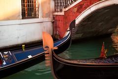 Venetian Traffic (janusz l) Tags: old city bridge venice window canal europe crossing traffic culture gondola venetian gondolas janusz leszczynski 232543 01312013