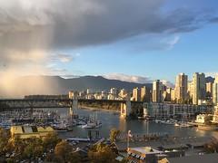 Vancouver, BC (Skellig2008) Tags: granvilleislandpublicmarket vancouver britishcolumbia raincloud burrardstreetbridge canadianflag buildings granvilleisland yachts mountains falsecreek weather rain