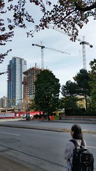 Station square construction looked upon by a young woman (D70) Tags: burnaby construction woman backpack street kingsway