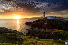 fanad head lighthouse (gregor H) Tags: countydonegal irland ie great lighthouses greatlighthouses lighthouse moring sunrise vista mood spirit moment nature landscape seascape cliffs sea open glowing morningglowing backlight colors orange blue green first fanadhead hiking trail rocks coast coastline irish dramaticsky dusk reflection sunlight illumination warmth travel ocean vacation pprowinner distagont3518 carlzeiss