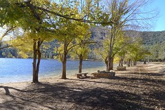 Lakeside (halifaxlight) Tags: morocco atlasmountains lake hills trees sunny car benches autumn shadows