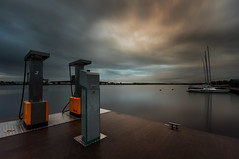 The pumps (- David Olsson -) Tags: longexposure morning autumn 2 orange lake fall water clouds port sunrise reflections boats dawn early dock nikon pumps diesel cloudy sweden harbour tripod sigma september gas pump karlstad le sailboats 1020mm buoys 1020 vnern hst 2012 dx vrmland ndfilter smoothwater smoothsky buoyant d5000 kanikenset davidolsson nd500 lightcraftworkshop kanikenshamnen almostovercast