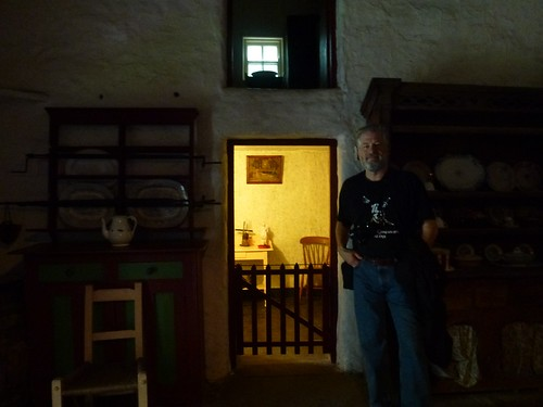 John in thatch house in folk park, Bunratty Castle