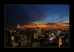 Sunset Over Manhattan (Seeing Things My Way...) Tags: sunset sky usa newyork skyline clouds america skyscraper unitedstates manhattan empirestatebuilding wtc cityskyline freedomneedle