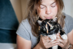 Unrequited (dmitriyk) Tags: cats girl rachel michigan detroit tortoiseshell angry calico paws nikkor addison annoyed lightroom raemarie 50mmf14d nikond200
