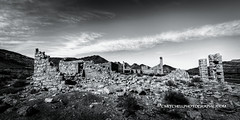 Rhyolite, NV {EXPLORE} (CMitchell Photo) Tags: road sky bw rock clouds landscape rocks dynamic lasvegas nevada roadtrip ghosttown chuck mitchell rhyolite range chuckmitchell d3s cmitchell giveusyourbestshot mitchellphotography cmitchellphotography cmichellphotography 522013week2