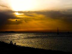 Waiting for the sun (emmebi89) Tags: sunset sea summer sky orange sun beach clouds boats boat waiting rocks hotair balloon rays