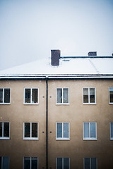 Sweden (Erica Gilbertson) Tags: houses windows roof winter light chimney sky cloud house snow cold window weather yellow clouds buildings outside snowflakes nikon day afternoon blind cloudy sweden stockholm foggy inside snowing nikkor sthlm hgersten downpipes aspudden 2818 nikond600 nikkor2818