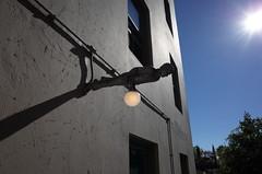 Lamp (panfriedcharlie) Tags: pikeplace seattle horizontal statue lamp bulb sun sky