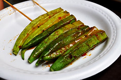 Hot okra (Roving I) Tags: barbecue okra vegetable chili skewers sauce plasticplates benthanhstreetfoodmarket dining tourism travel hcmc hochiminhcity vietnam