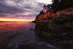 Candela (Brian Truono Photography) Tags: acadia bassharbor hdr highdynamicrange maine nps nationalpark nationalparkservice clouds coast geology glow guide headlight landscape light lighthouse natural nature ocean rock rocks sky stone sunset travel trees water waves tremont unitedstates us