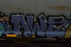 AWE (TheGraffitiHunters) Tags: graffiti graff spray paint street art colorful freight train tracks benching benched awe hopper